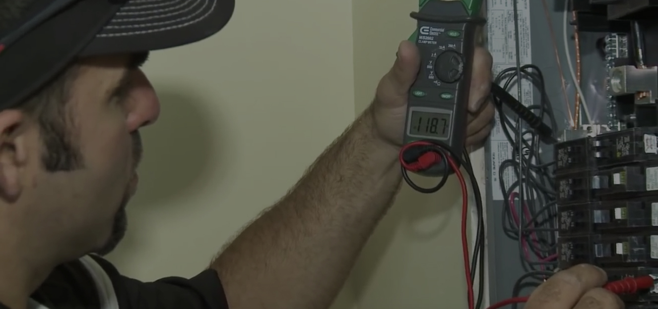 Man holding a voltmeter